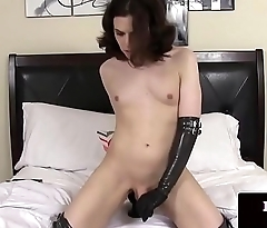Latex trans toying her ass with dildo