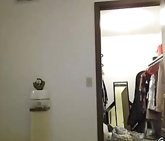 A girl shows her clothes front the webcam